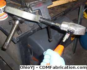 Using a hammer to help remove axle joints
